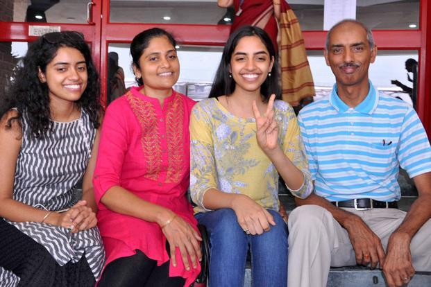 Raksha Gopal (third from left), who was declared topper of CBSE Class 12 results with 99.6% marks, with her family in Noida on Sunday. Photo: PTI