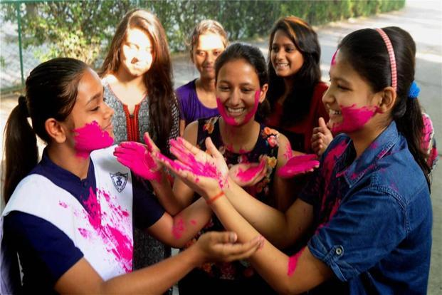 Students celebrate after the CISCE declared the results for class X and XII on Monday. Photo: AP