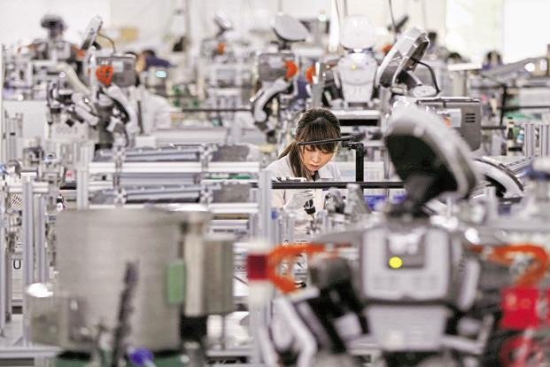 Manufacturing exports in Germany, Europe's largest economy, already make up more than a third of GDP; in Japan that stands at 12%. They're also both early robot adopters. Photo: Reuters