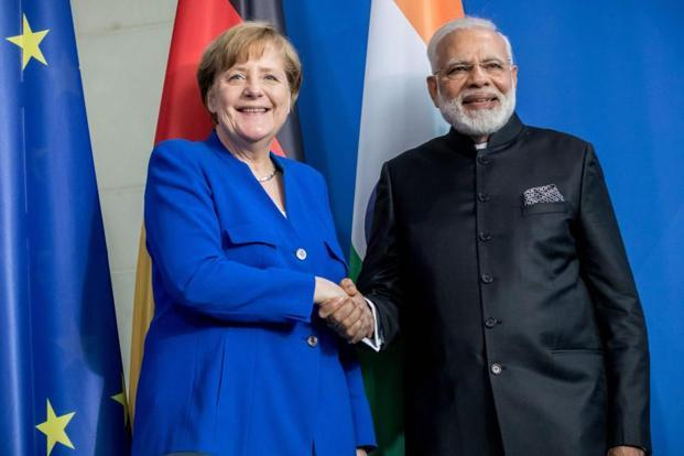 German Chancellor Angela Merkel and Prime Minister Narendra Modi shake hands during a press conference after the inter-governmental consultations in Berlin on Tuesday. Photo: Michael Kappeler/PTI