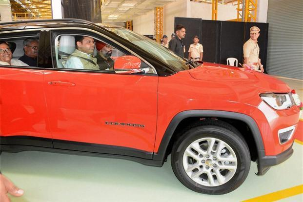 Maharashtra CM Devendra Fadnavis in the driver's seat of the first Made in India Jeep Compass at Fiat's Ranjangaon facility near Pune on Thursday. Photo: PTI