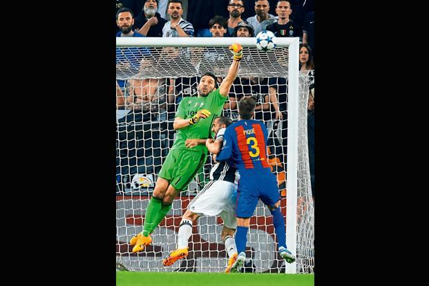 Buffon makes a save during the Champions League quarter-final first-leg match against Barcelona on 11 April at the Juventus stadium in Turin. Photo: AFP
