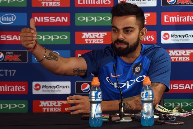 While addressing the media ahead of India's Champions Trophy 2017 opener against arch-rivals Pakistan, captain Virat Kohli said that he understands the media has a job to do and he would rather focus on his—playing cricket. Photo: AFP