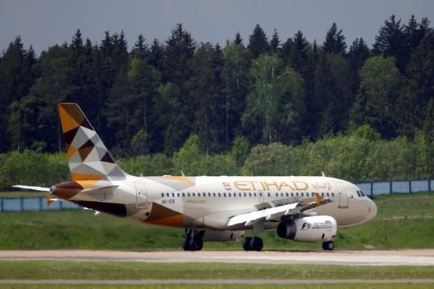 UAE's Etihad to suspend flights to Qatar