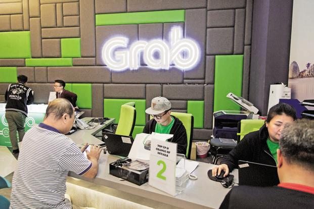 Grab facilitates as many as 2.5 million rides each day, making it the largest ride-hailing platform in Southeast Asia with over 930,000 drivers in 55 cities and seven countries. Photo: Bloomberg