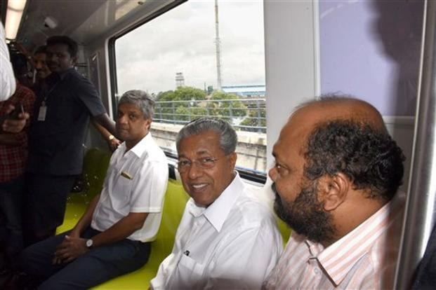 A file photo. Kerala chief minister Pinarayi Vijayan, who is also the minister in-charge of Kochi Metro, travels in a metro train during a trial run in Kochi. Photo: PTI
