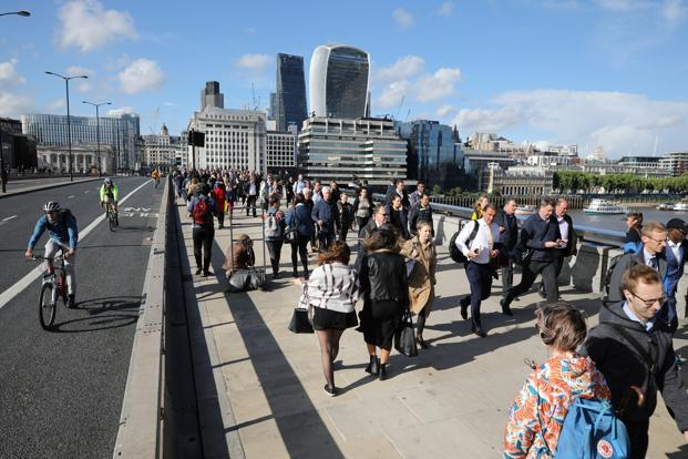 Pedestrians walk over London Bridge which witnessed recent terror attack near Borough Market in London on Tuesday. Photo: Reuters