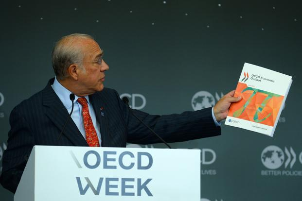 OECD general secretary Angel Gurria presents an OECD Economic Outlook document in Paris on 7 June. Photo: AFP