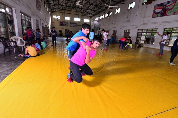 Ahlawat sisters practice wrestling in a stadium at Rohtak. Photo: Priyanka Parashar/Mint