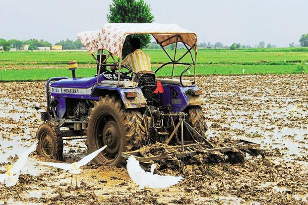 ICRA said that a pick-up in the rural economy will be positive for retail loan asset classes like tractor and microfinance loans. Photo: Ramesh Pathania/Mint