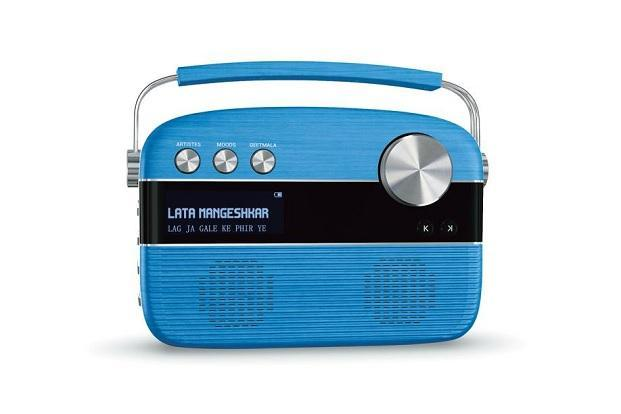 Saregama Carvaan is a multipurpose portable music player which looks like an old radio set with big buttons, a jog-dial, an inbuilt speaker and a small screen that displays the name of the song being played.