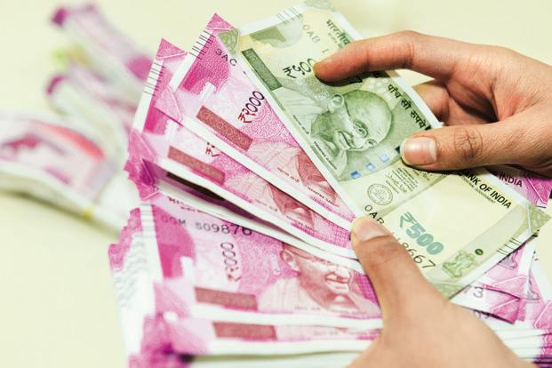 The rupee opened at 64.28 a dollar and touched a high and a low of 64.17 and 64.34, respectively. Photo:  Mint