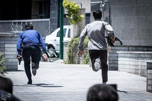 Members of Iranian forces run during an attack on the Iranian parliament in central Tehran on 7 June. Photo: Reuters