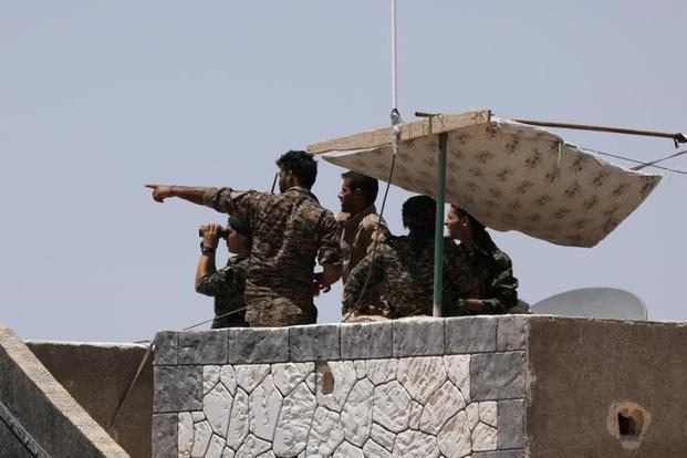 Syrian fighters seize parts of Islamic State 'capital' Raqqa
