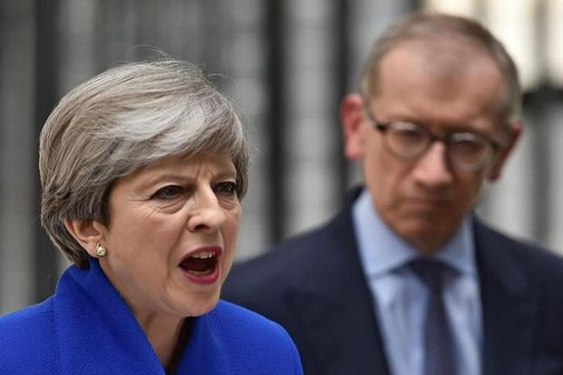 British Prime Minister Theresa May addresses the country as her husband looks on after Britain's election at Downing Street in London, Britain, on  9 June. Photo: Hannah Mckay/Reuters