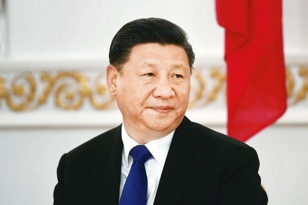 Xi Jinping wants China to host the World Cup and also hopes the country's national team can one day win football's most prestigious trophy. Photo: Reuters