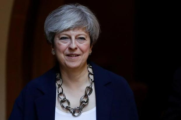 The new Cabinet appointments will be seen as Theresa May's attempt at surrounding herself with as many allies as possible against the backdrop of a brewing rebellion within party ranks . Photo: Reuters