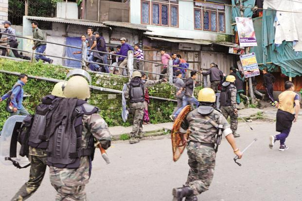 Policemen charge at protesters on the second day of a strike called by the Gorkha Janmukti Morcha in Darjeeling on Tuesday. Photo: AFP