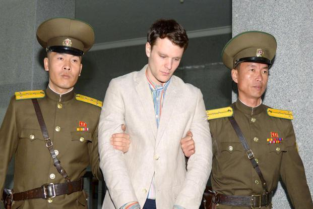 In March 2016, North Korea's highest court sentenced Warmbier to 15 years in prison with hard labor for trying to steal a propaganda banner. Photo: Reuters