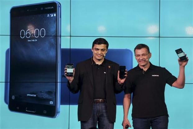 HMD Global's  chief marketing officer Pekka Rantala (R) with the company's vice president (India) Ajey Mehta during the India launch of Nokia 6, 5 and3 smartphones in New Delhi on Tuesday. Photo: PTI