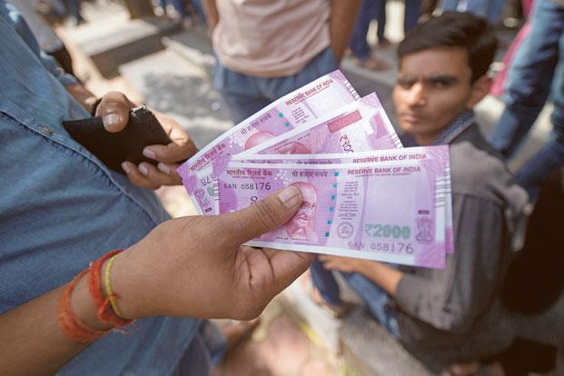 The rupee opened at 64.44 a dollar and touched a high and a low of 64.34 and 64.49, respectively. Photo: Mint