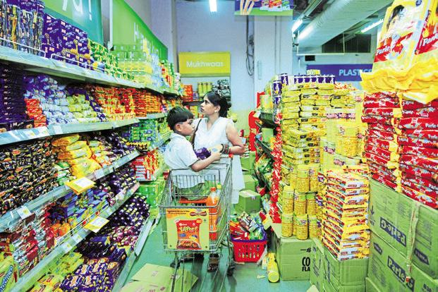 Retailers' biggest concern is to ensure that margins are not hurt as they reduce prices. Retailers said they were coordinating with packaged consumer goods makers independently. Photo: Pradeep Gaur/Mint