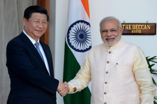 China's Xi Jinping and PM Narendra Modi. India will be faced with a daunting challenge as the construction and other activities pick up in China-Pakistan Economic Corridor (CPEC) through Pakistan Occupied Kashmir (PoK) in the years ahead. Photo: AFP