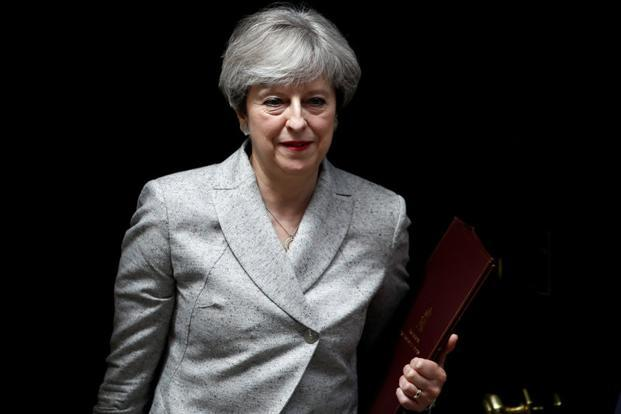 Weakened by an election that was intended to strengthen her, Britain Prime Minister Theresa May is now working to regain some of her lost standing. Photo: Reuters