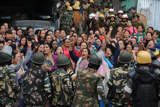 The police personnel stop Gorkha Janmukti Morcha (GJM) supporters following a raid at the GJM office in Darjeeling on Thursday. Photo: Diptendu Dutta/AFP