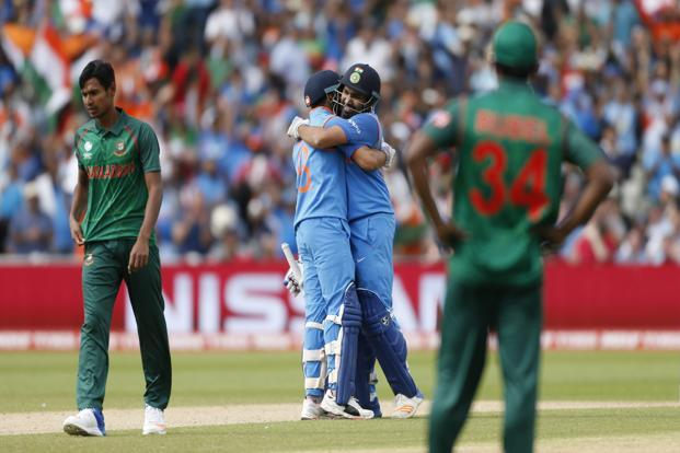 India's Rohit Sharma with captain Virat Kohli after scoring his century in the Champions Trophy semifinal match against Bangladesh, in Edgbaston on Thursday. Photo: Reuters