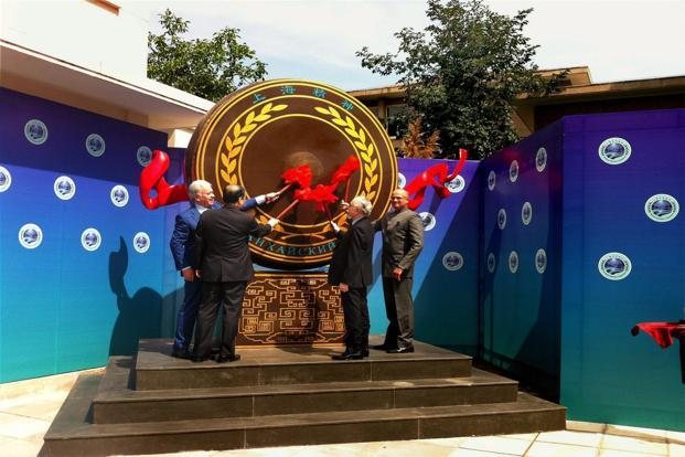 India and Pakistan officials with other dignitaries beating the drum heralding the admission of India and Pakistan as new members of the SCO in Beijing on Thursday. Photo: PTI