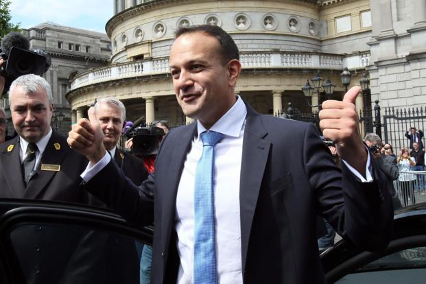 Leo Varadkar waves to colleagues as he leaves parliament in Dublin after being confirmed as Ireland prime minister on 14 June. Photo: AFP
