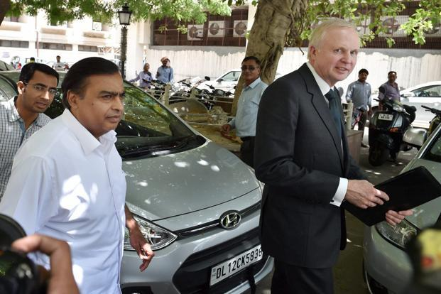 Mukesh Ambani and Bob Dudley coming out after their meeting with Dharmendra Pradhan at Shastri Bhawan in New Delhi on Thursday