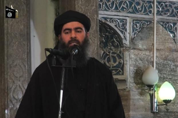 A file photo of Abu Bakr al-Baghdadi. The ministry says the strike came as Islamic State leaders gathered to discuss the group's withdrawal from Raqqa, the group's de facto capital. Photo: AFP