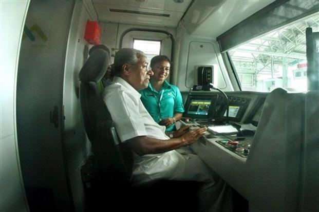 A file photo of Kerala chief minister Pinarayi Vijayan travelling in the Kochi Metro. The city metro has been commissioned in a record time of 45 months as compared to other metro services in the country. Photo: PTI