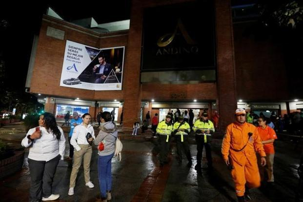 People, police officers and rescue personnel stand outside the Andino shopping center after an explosive device detonated in a restroom, in Bogota, Colombia on Saturday. Photo: Reuters
