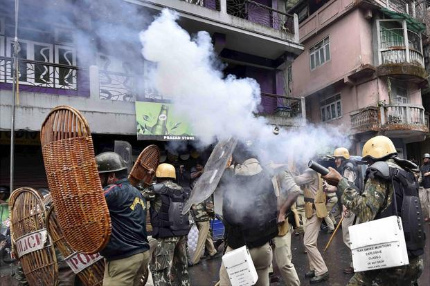 Security personnel fire tear gas shells during a protest by GJM activists in Darjeeling on Saturday. Photo: PTI