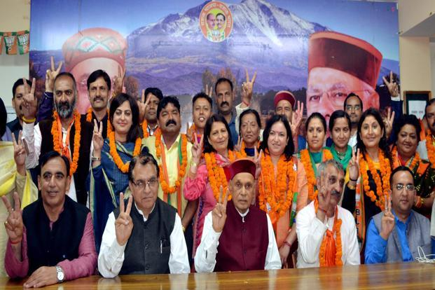 Newly-elected BJP councillors with former chief minister Prem Kumar Dhumal in Shimla on Saturday. Photo: PTI