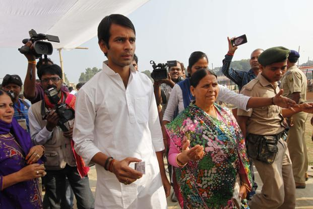 A file photo of Tej Pratap Yadav with his mother Rabri Devi. Photo: Hindustan Times