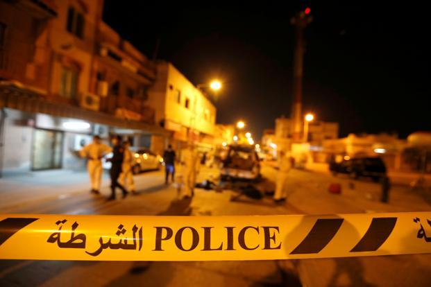Police and crime scene officials near the scene where a blast killed one and seriously injured two police officers in the village of Diraz west of Manama, Bahrain. Photo: Reuters