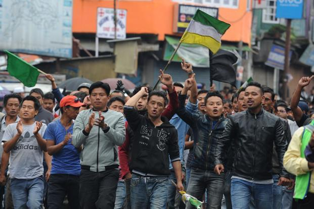 Supporters of GJM shout slogans while demonstrating during an indefinite strike called in Darjeeling on Monday. Photo: AFP