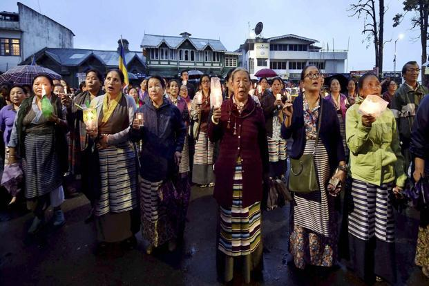 People from the Tibetan community take part in a candle light march in Darjeeling on Monday. Photo: PTI