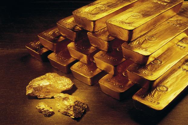 Gold edges down on firm dollar; Dudley's comments awaited