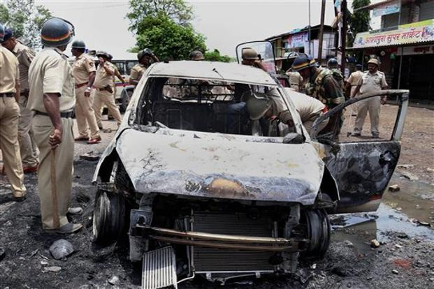 The protestors torched six police vehicles and blocked Thane-Badlapur highway even as the state government deployed two companies of Special Reserve Police and Riot Control Police to control the situation. Photo: PTI