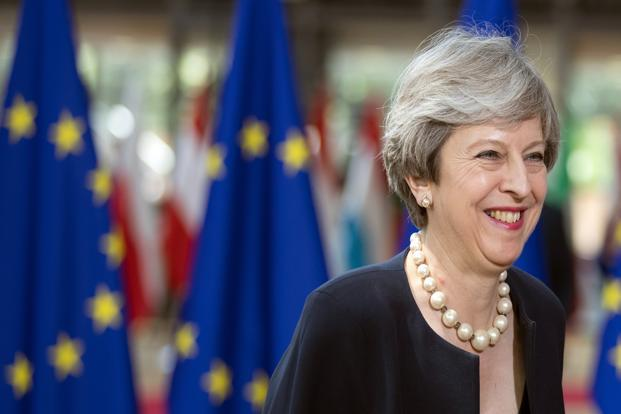 Theresa May will outline her plan to provide early guarantees for some three million people from other EU countries living in Britain. Photo: Jasper Juinen/Bloomberg