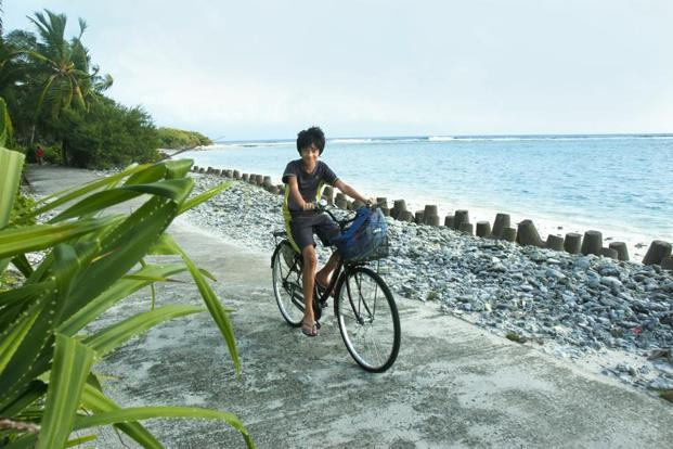 Exploring the island on cycle.