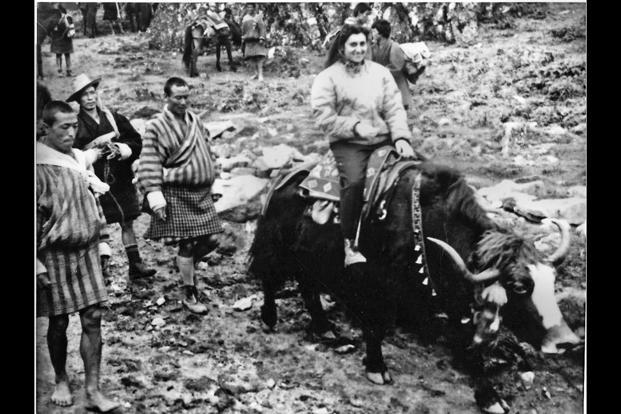 Indira Gandhi riding a yak in Bhutan, 1958. courtesy simon & schuster
