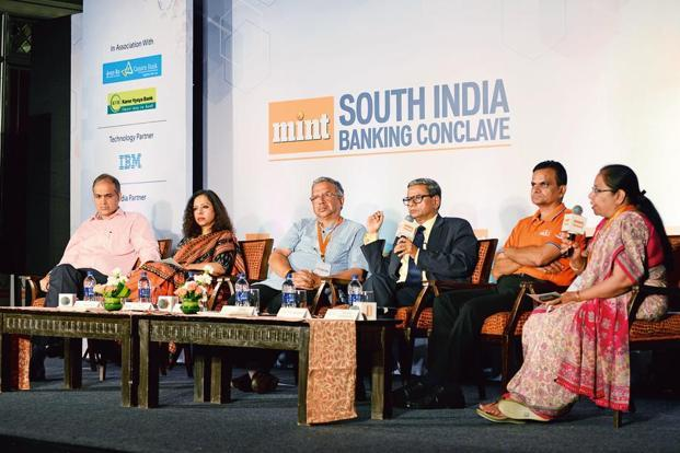 (From left) Disha Microfin chief executive officer Rajeev Yadav; Microfinance Institutions Network CEO Ratna Vishwanathan; Ujjivan Small Finance Bank MD and CEO Samit Ghosh; Mint's consulting editor Tamal Bandyopadhyay, Equitas Small Finance Bank Ltd MD and CEO P.N. Vasudevan; IBM senior partner and vice-president, country lead (BFSI), global business services, Gayathri Parthasarathy at a panel discussion during Mint's Annual South India Banking Conclave. Photo: Hemant Mishra/Mint