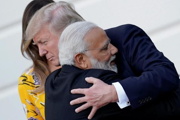 Prime Minister Narendra Modi hugs US President Donald Trump at the White House in Washington US on Monday