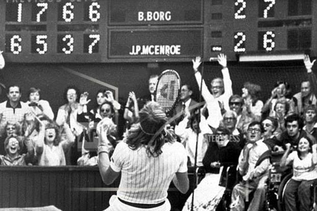 Björn Borg sinks to his knees after hitting the winning shot in the men's singles final against John McEnroe at Wimbledon 1980 and winning The Championships for the fifth consecutive time. Photo: AP